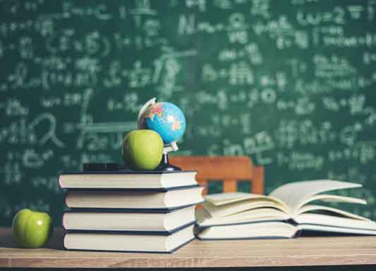 Photo of desk, books & chalkboard link to Berlin Twp. School District