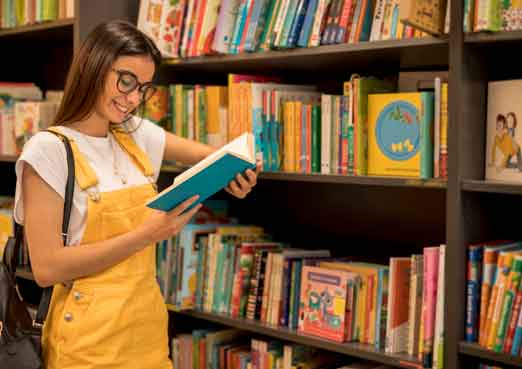 Photo of library books on shelves link to library page